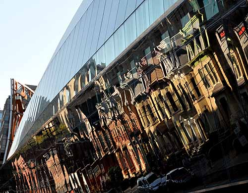 Second Empire block on Dundas Street Toronto reflected in the stunning facade of Frank Ghery's AGO